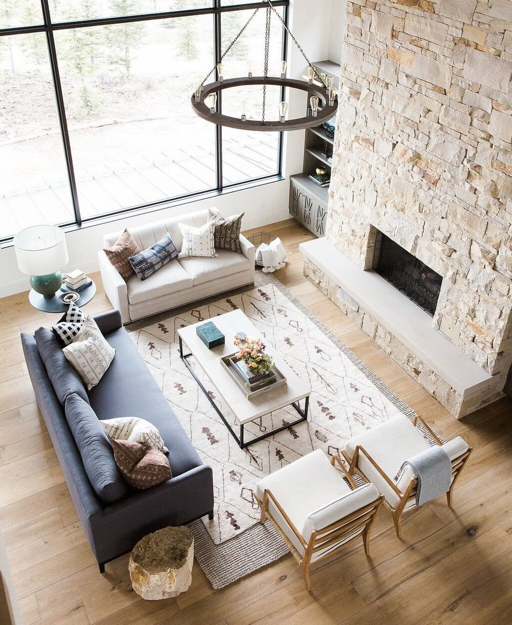 Great+room+with+dramatic+stone+fireplace,+layered+rugs,+and+neutral+color+scheme.jpg