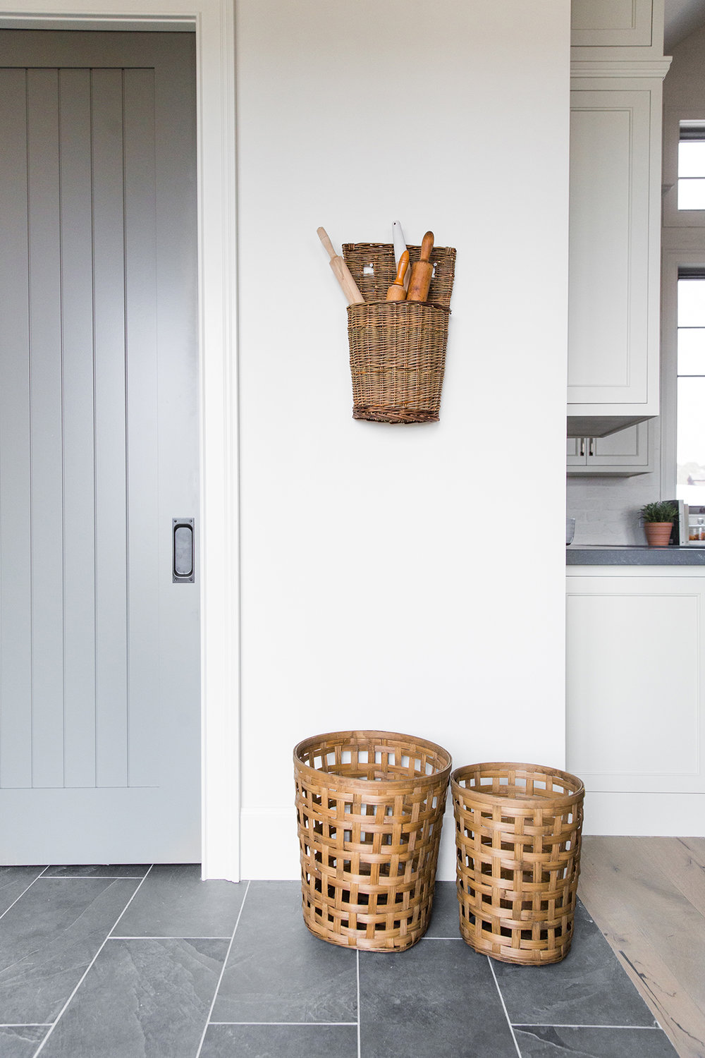 Hanging basket with rolling pins in corner of kitchen - Studio McGee Design