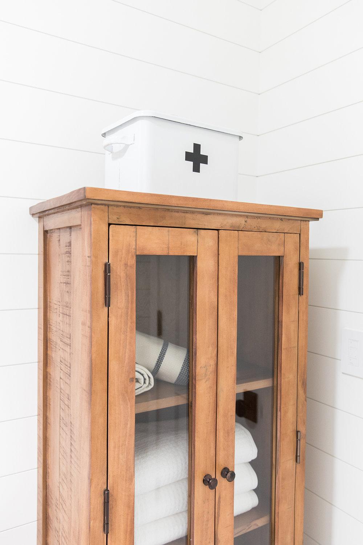 Bathroom storage in coastal home, shelving unit in bathroom