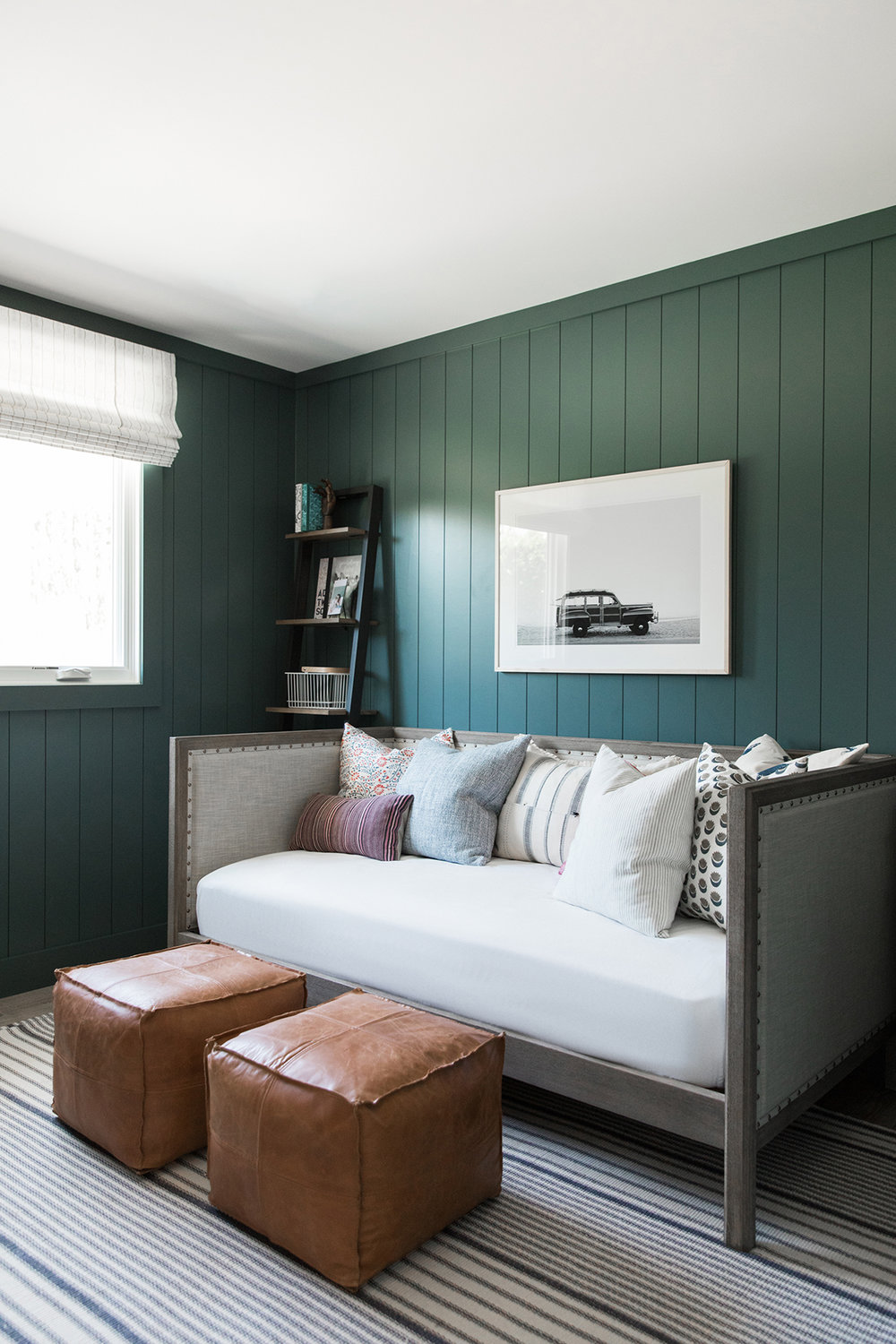 Cool and moody office space, dark office space with vertical paneling, playroom with daybed, dark room with daybed | Studio McGee Blog