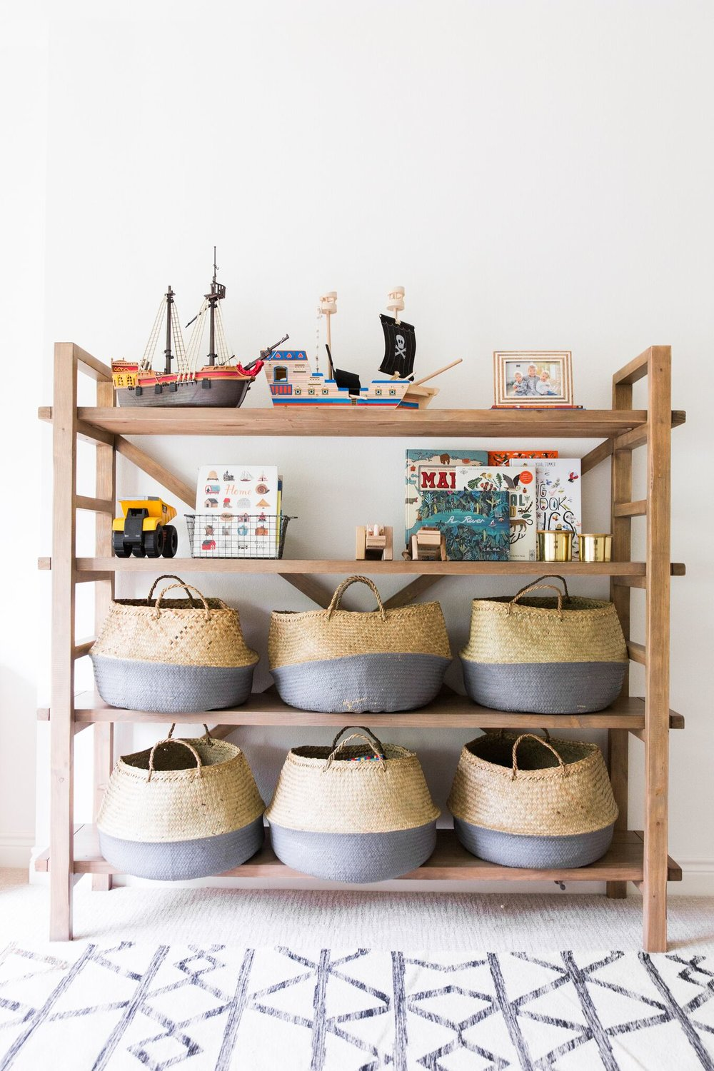 Shelving and Baskets for Toy Storage in Coastal Bohemian Kids' Playroom