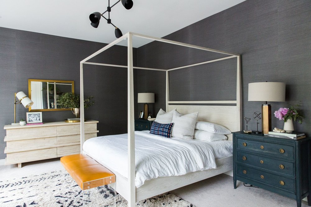 Moody Bohemian Master Bedroom with Dark Grasscloth Wallpaper, Four Poster Bed, and Modern Lighting