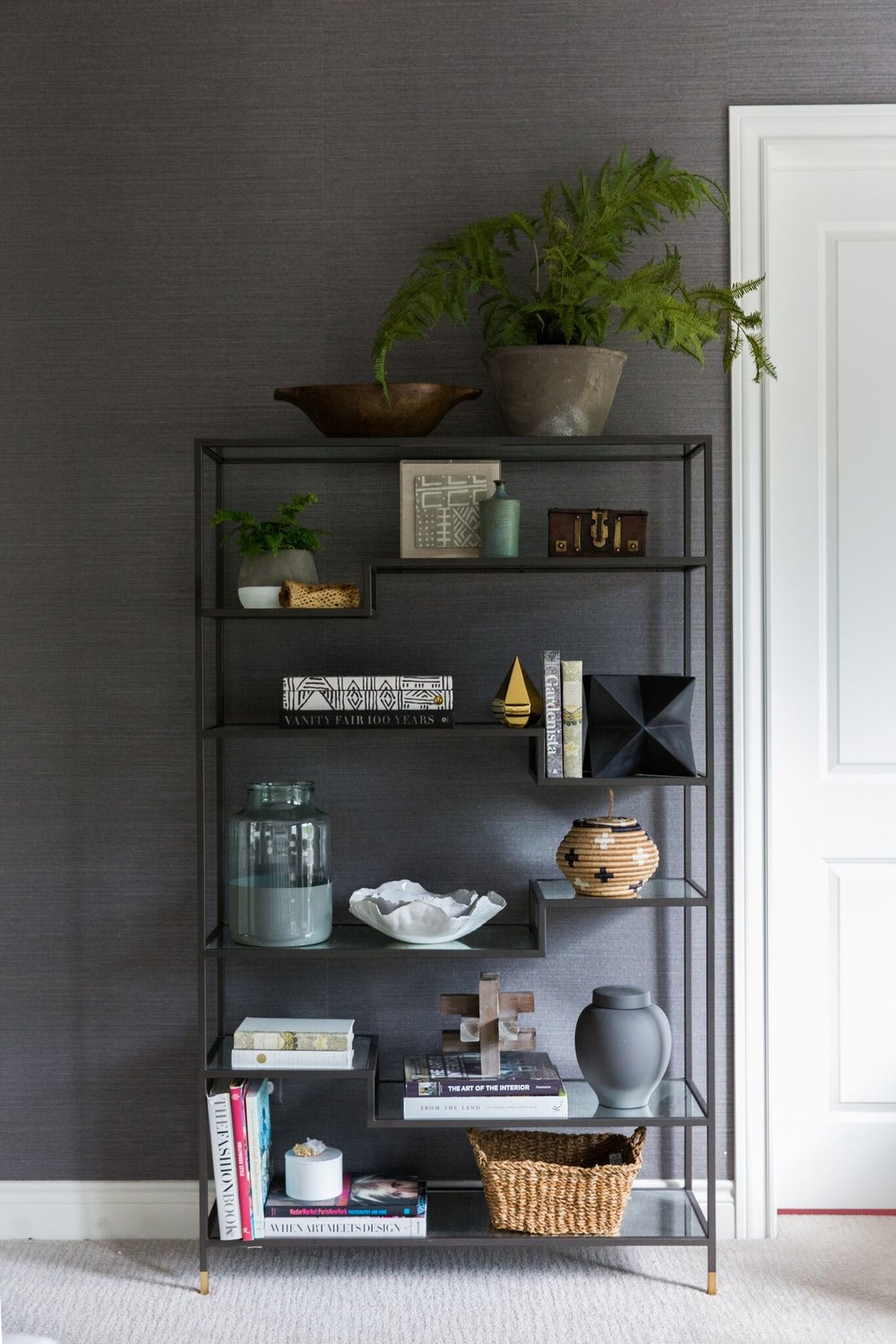 Eclectic Bookcase with Collected Display Pieces and Greenery