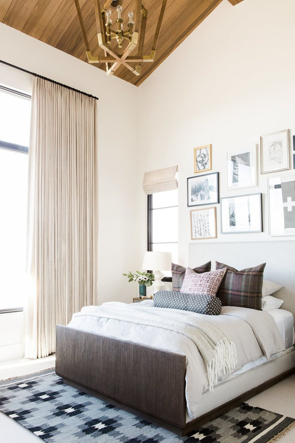 Guest bedroom with gallery wall