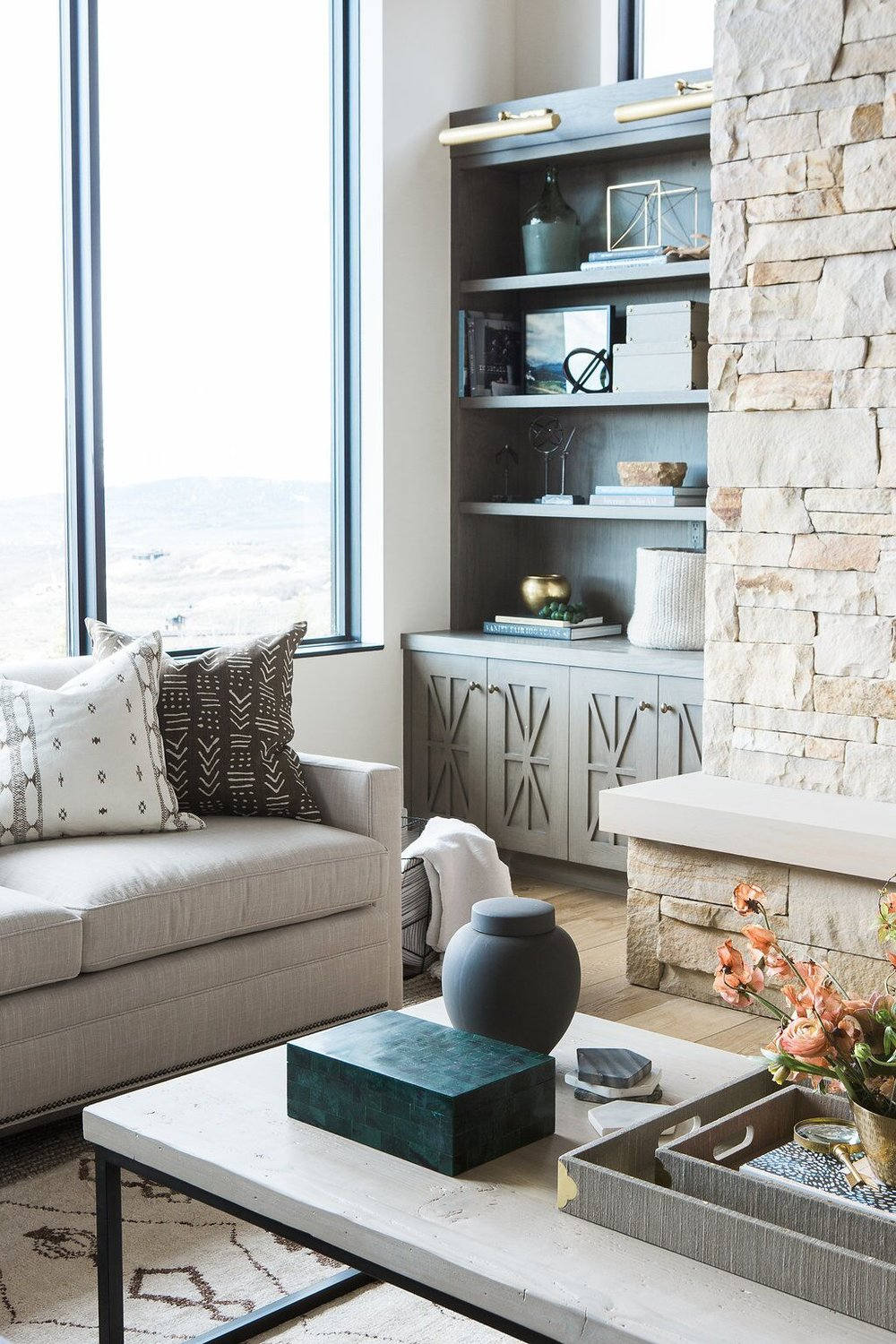 Stone fireplace and stained natural wood built-in cabinets