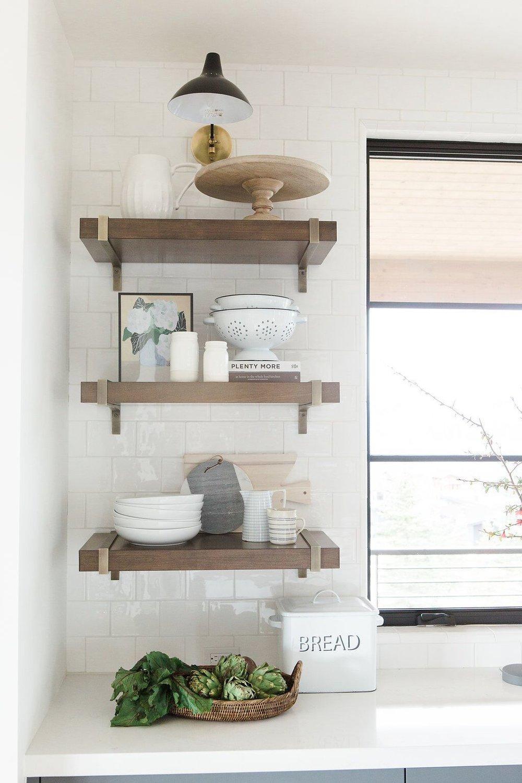 Dark walnut open shelving with kitchen accessories