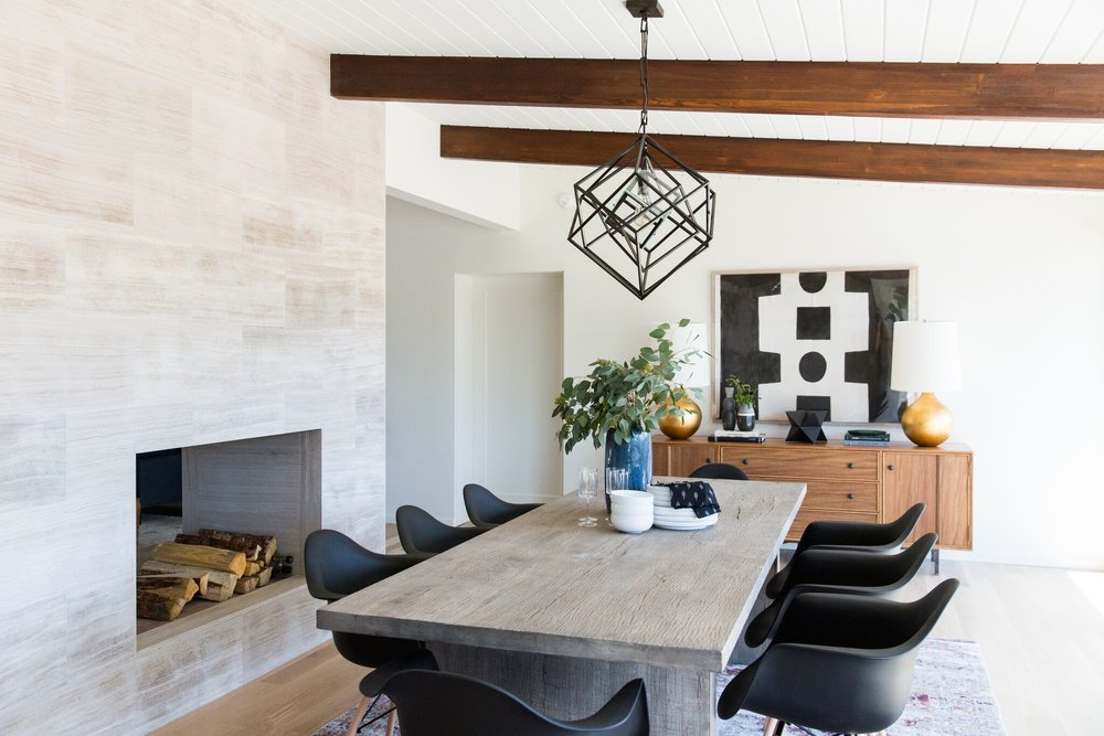Mid-Century Dining Room with Vintage Rug and Modern Artwork