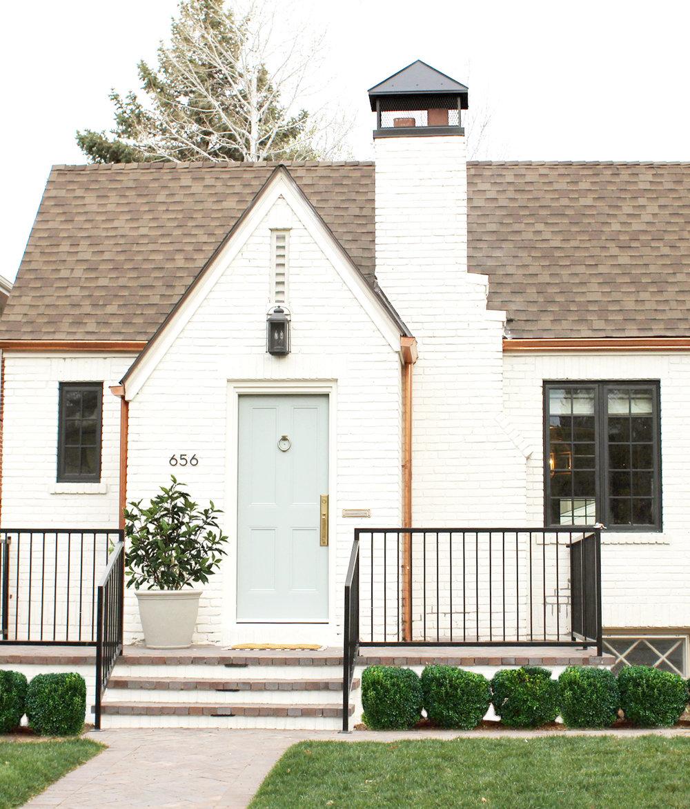 White Brick Tudor House and Front Door in Benjamin Moore's