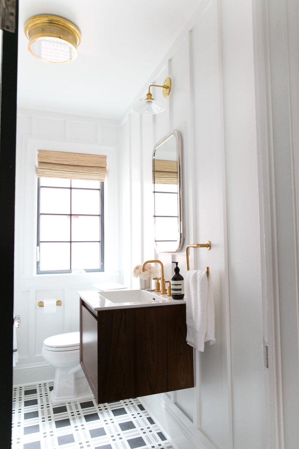 Modern bathroom with patterned title, and floating vanity.